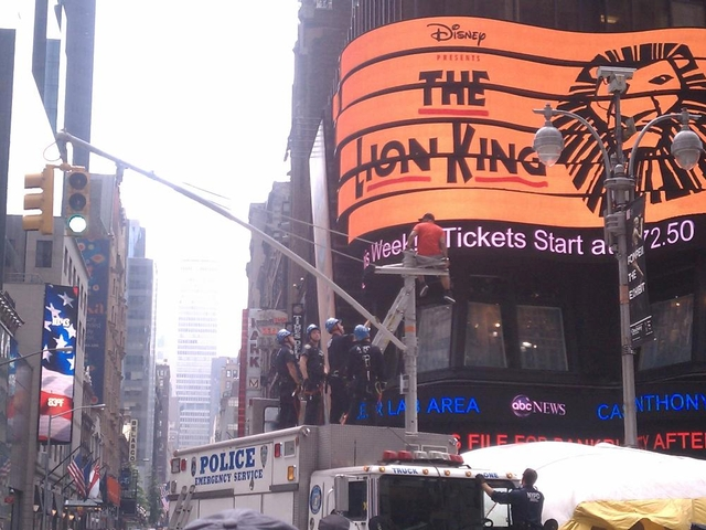 A man on a light pole in Times Square on Tuesday.