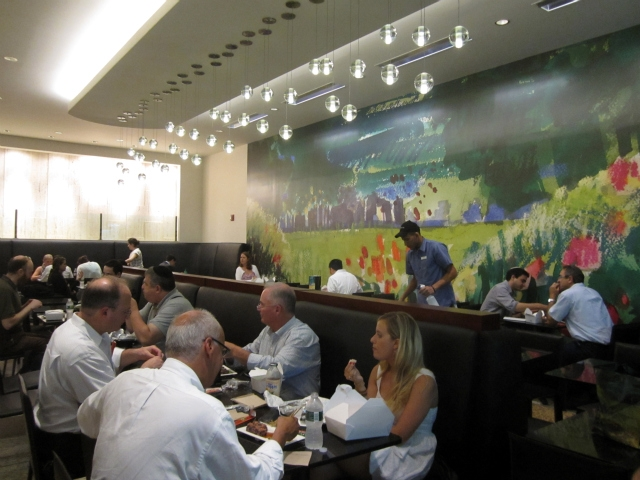 The new Milk Street Cafe includes a large mural of its logo, a painting meant to symbolize freshness.