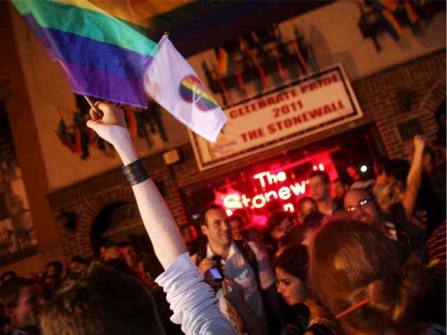 Crowds wave the rainbow flag to celebrate the historic legislation.