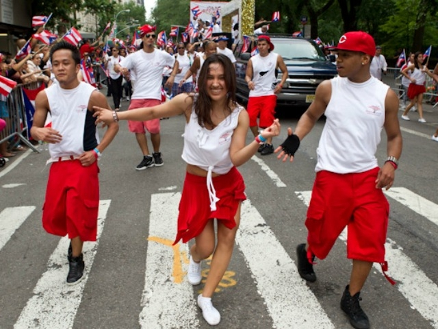 Dancers  enjoy the parade on Fifth Avenue.