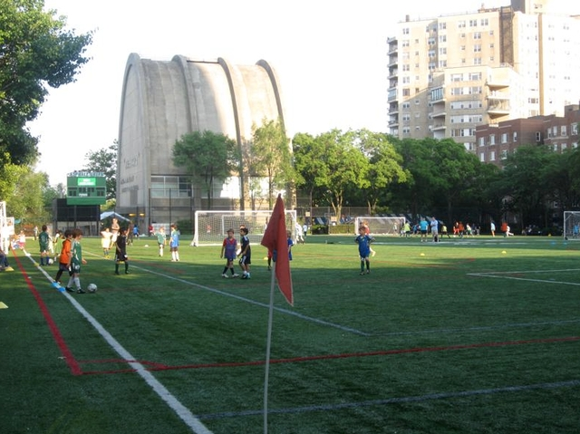 Residents worry that trucks from the East 91st Street waste transfer station will stink up the popular Asphalt Green ball fields.