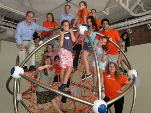 Staff and participants on top of Exerblast's popular Climb-A-Tron.