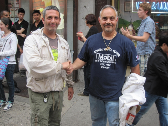 NYPD beekeeper Tony Planakis (r.) and Andrew Cote of the NYC Beekeepers Association shook hands after their successful rescue effort.