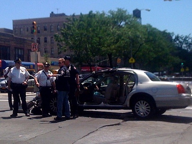 Cops investigate aftermath of crash at W. 145th Street and Seventh Avenue.