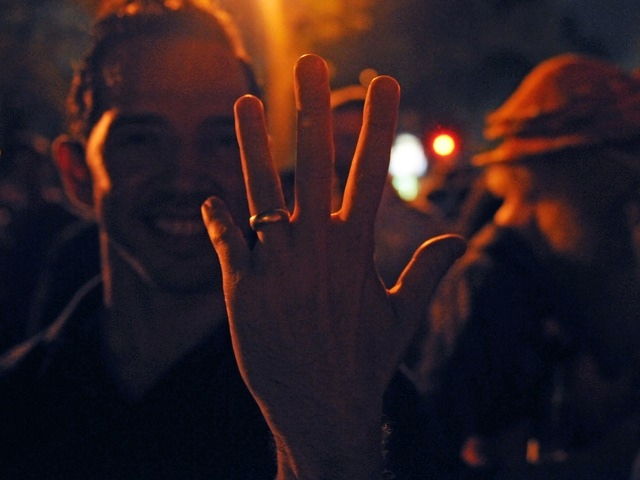 There's a nice ring to it.  Mel England, 41, celebrates the passage of gay marriage near the historic Stonewall Inn Friday night.