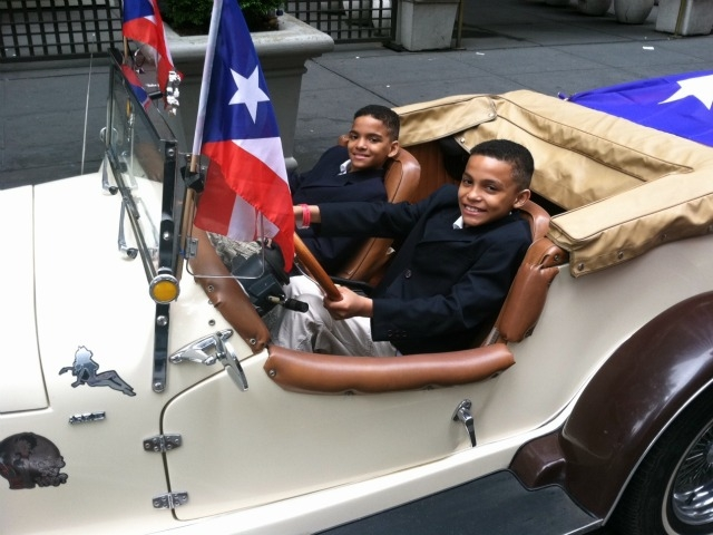 Jeremy Manzanet,10, of The Bronx, (l.) and his twin brother Justin, gear up for their first Puerto Rican Day parade Sunday in a 1929 Mercedes.