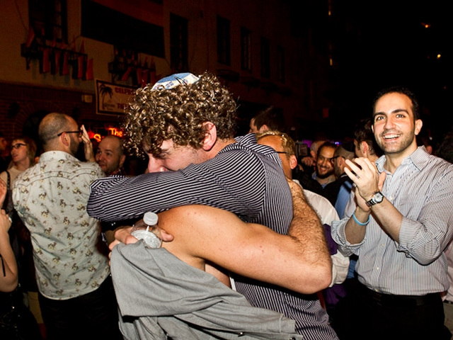 Erick Cohen, 20, (l) and his partner Noah, 21, got engaged outside the Stonewall Inn in Greenwich Village Friday night after historic gay marriage legislation passed the state Senate.