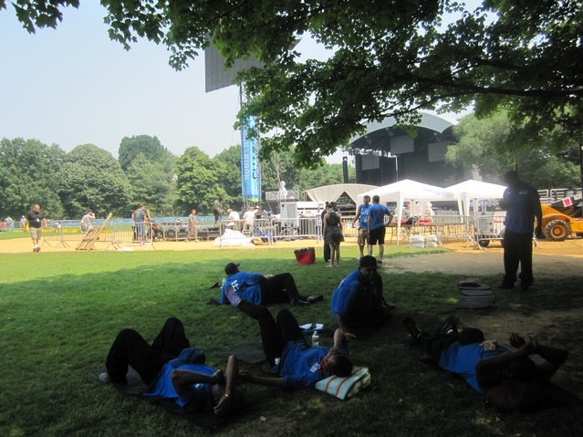 Workers rest before Thursday's Black Eyed Peas show.
