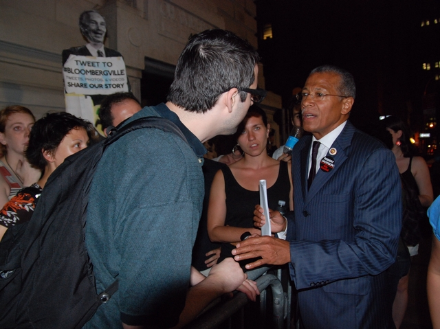 City Councilman Robert Jackson was one of the few members who stopped to speak with the dozens who protested outside.