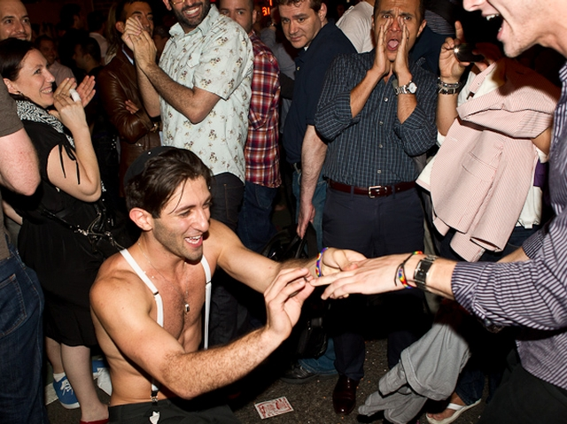 Erick Cohen, 20, proposes to his partner Noah, 21 outside the Stonewall Inn Friday night.