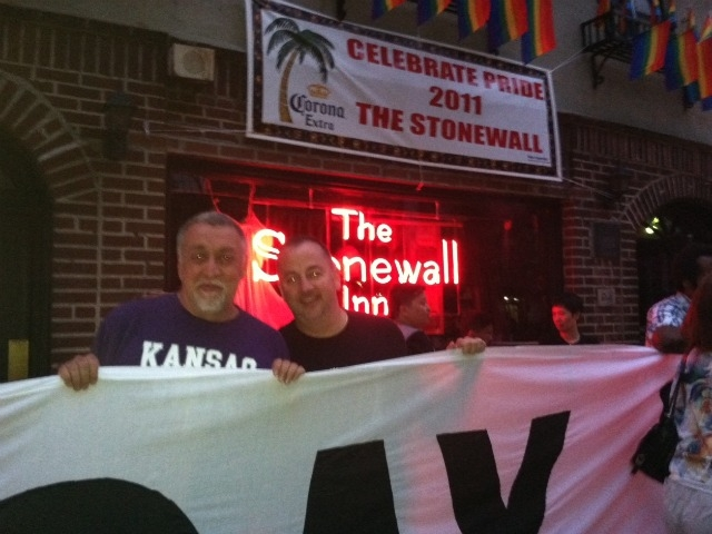 Supporters gather outside the Stonewall in the Village.