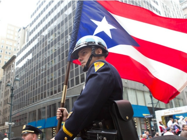 A mounted unit cop displays the flag of Puerto Rico.