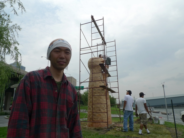 Artist Akihiro Ito with his sculpture