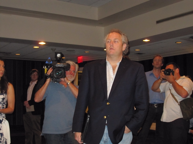 Andrew Breitbart stood by before Weiner spoke.