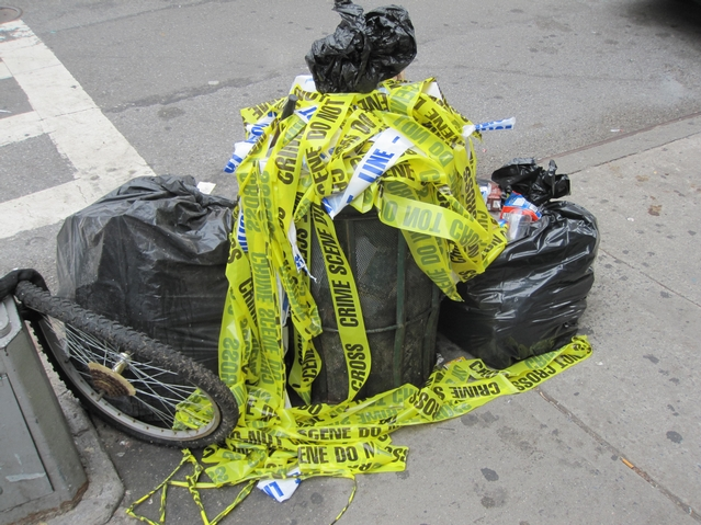Police tape filled a garbage can at the corner of Pitt and Rivington streets.