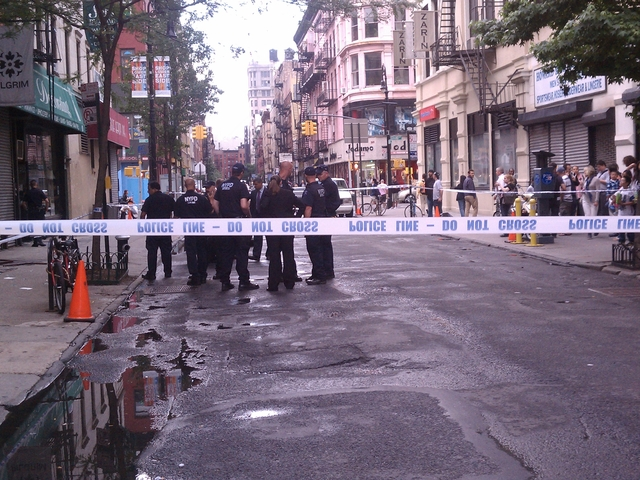 Police close off Orchard Street near Broome Street after a shopowner was wounded in an apparent attempted robbery.