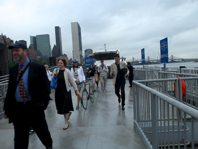 Ferry riders disembark at East 34th Street at Monday's maiden voyage.