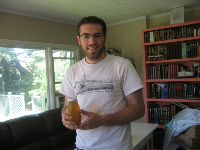Beekeeper Elie Miodownik, with a jar of honey produced by his bees.