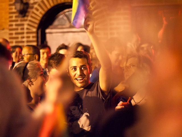 Revelers cheer the passage of historic gay marriage legislation outside the Stonewall Inn in the Village.