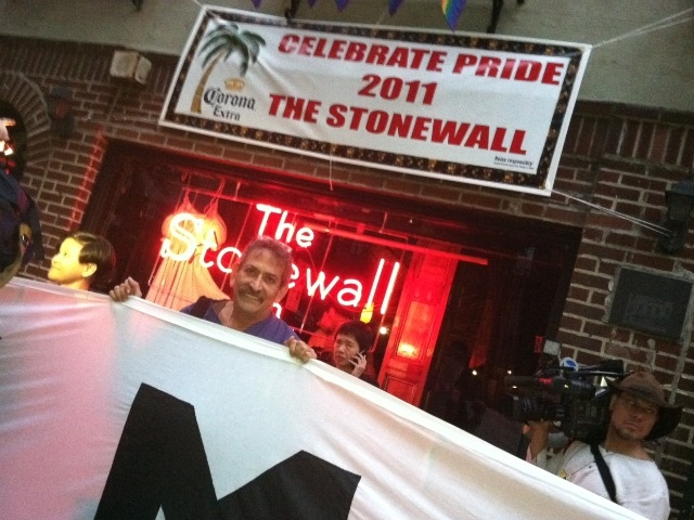 Gay marriage proponents gather outside the Stonewall Tavern.