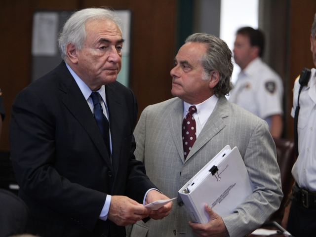 Dominique Strauss-Kahn speaks to his lawyer in court.