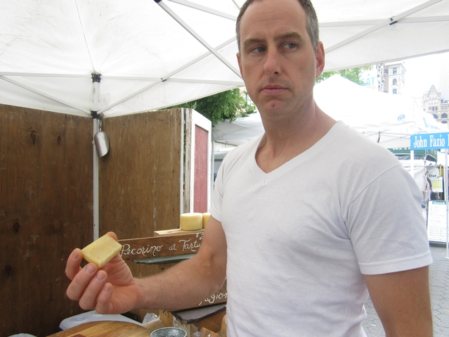 Jody Somers of Dancing Ewe Farm's stand at the Union Square greenmarket wonders how he can cut his aged cheese with a plastic knife.