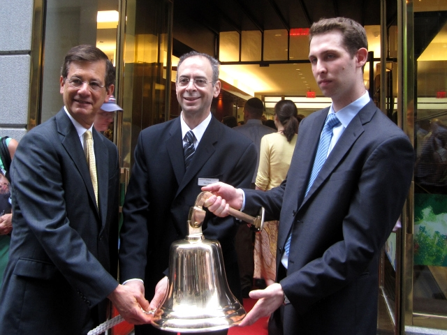 Deputy Mayor Stephen Goldsmith and Milk Street Cafe owner Marc Epstein, center, ring a bell to open the cafe.