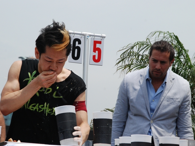 Takeru Kobayashi downed 69 hot dogs Monday at a dueling contest in the Flatiron District.