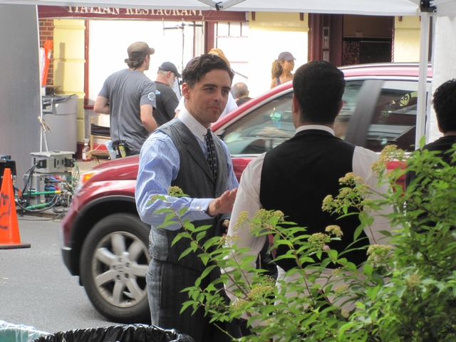Vincent Piazza, who plays Lucky Luciano, chatted with a cast-member in between takes.