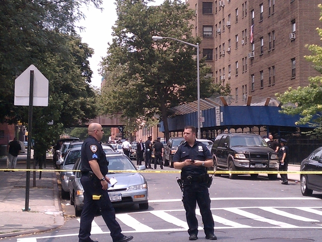 Cops investigate a shooting at 112 E. 128th St. in East Harlem Wednesday afternoon.