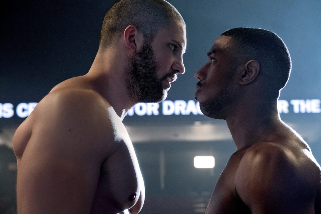 """72998ca5 Florian Munteanu (left) and Michael B. Jordan fight like their fathers  before them in """"Creed II."""" Photo: Barry Wetcher, Warner Bros. Pictures"""