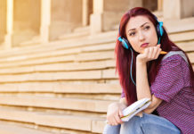 Girl sitting on steps thinking