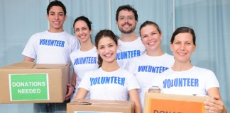 Volunteers holding donation boxes