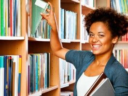 Girl taking out book from library