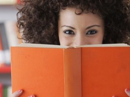 Girl holding orange book