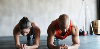 man and woman working out together