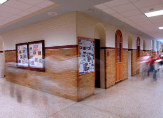 Busy school hallway and exit sign