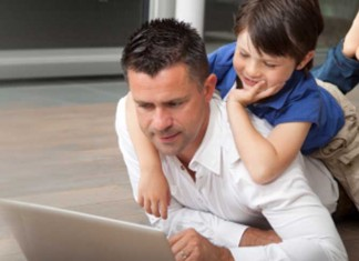 Man working from home with son