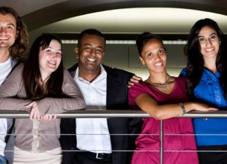 Group of diverse people standing on a balcony