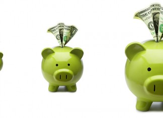 Three piggy banks with dollars sticking out