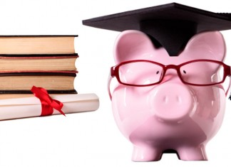 Piggy bank wearing graduation cap, books, and diploma