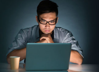 Younger male using his computer