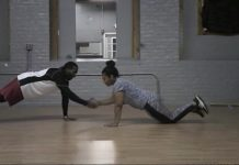 Two students working out together
