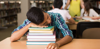 Boy sleeping on books