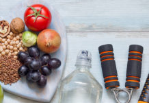 Plate of healthy food, water bottle, and jumprope