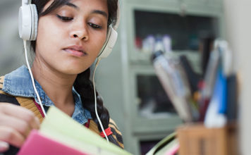 Girl studying, listening to music