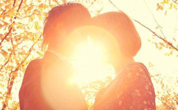 Couple standing in sunlight