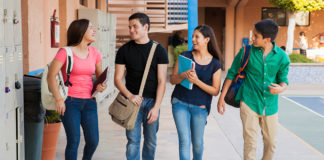 Group of students talking in the hallway between classes