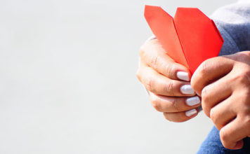 Male holding Valentines Day card