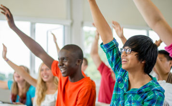 Students raising their hand in class